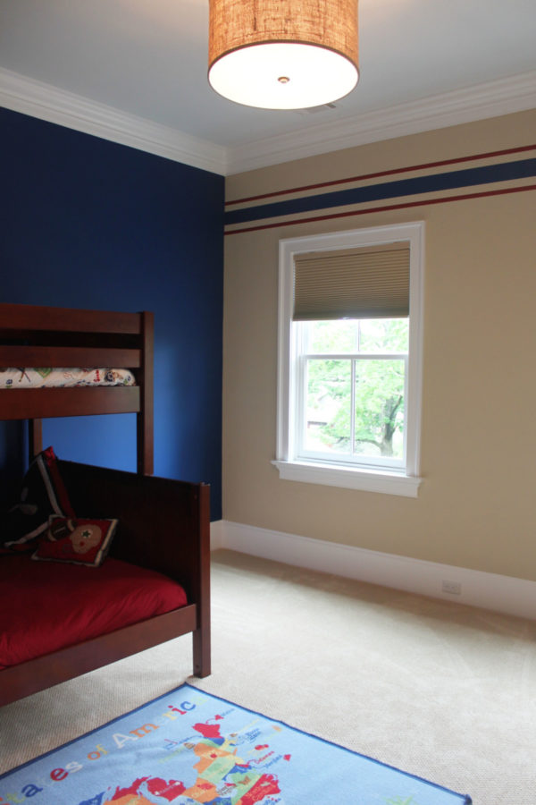 Deep Blue Accent Wall in Boy's Room