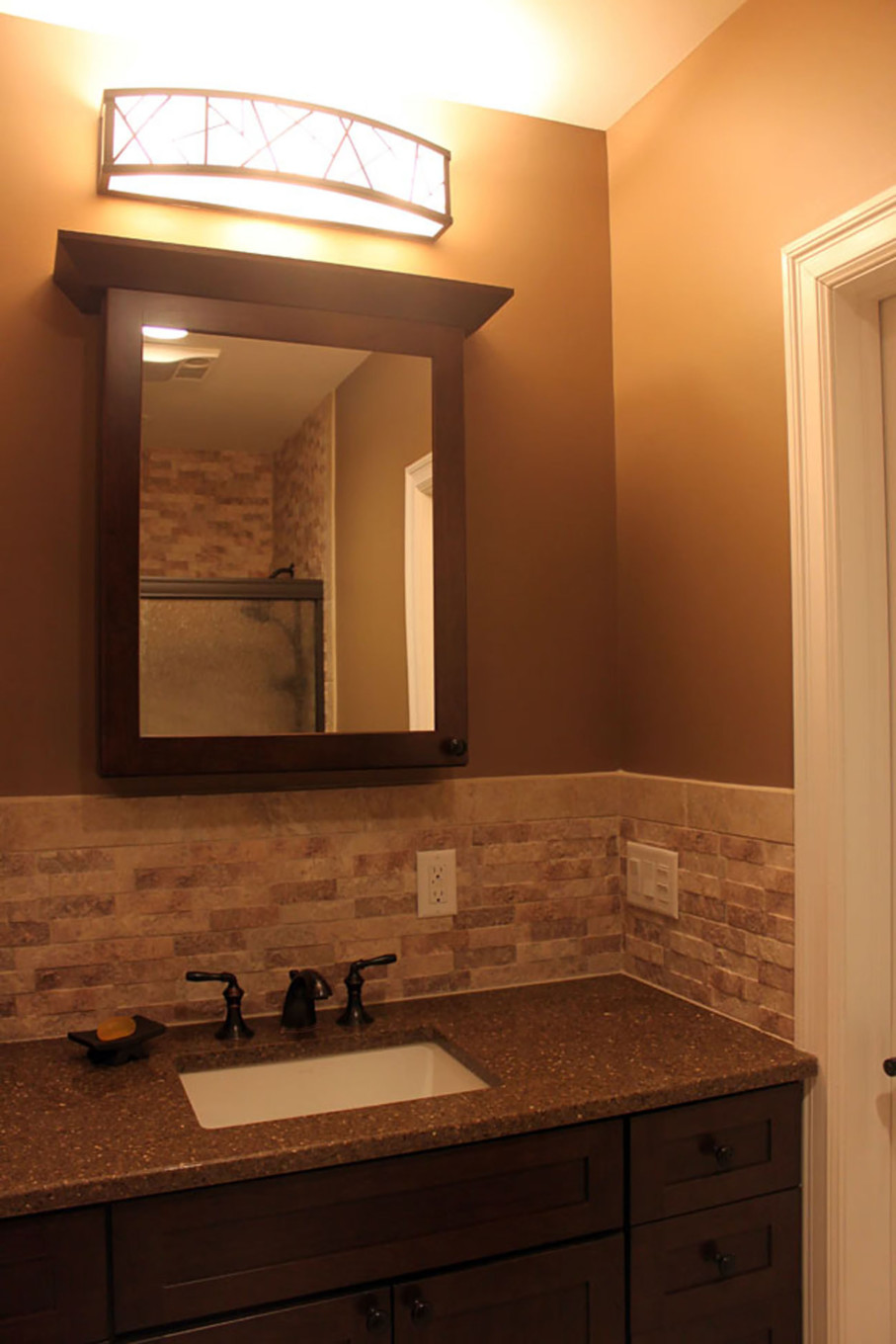 Deep Earth Tones on Wall to Enhance Guest Bathroom