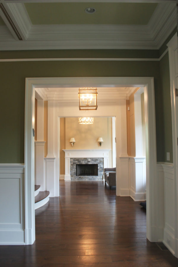 Shades of Warm Green and Golds in Dining Room, Hallway, and Living Room