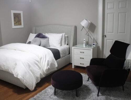 Gray and White Bedroom with a Touch of Purple