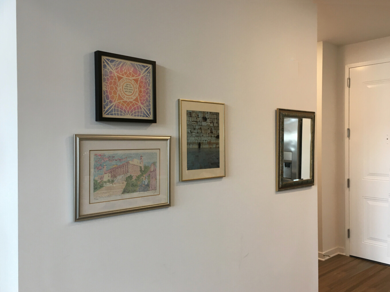 Hanging art in entrance to apartment